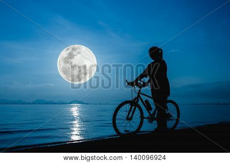 Silhouette Of Healthy Biker-girl Enjoying The View At Seaside