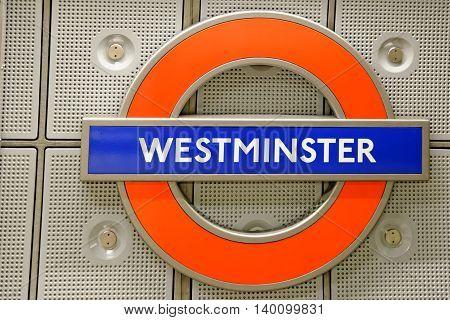 LONDON UK - JULY 1 2014: Underground station sign Westminster. The London Underground is the oldest underground railway in the world.