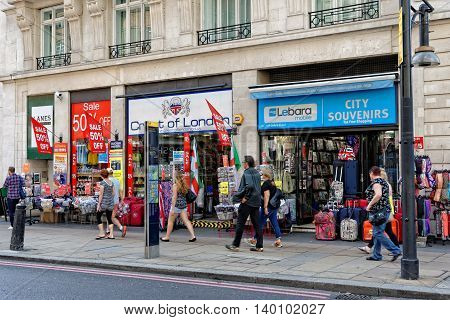 LONDON - JULY 1 2014. People walk past a popular souvenirs shop on Oxford street in London. This is the biggest shopping street in Europe visited by millions of tourists.