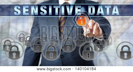Corporate manager is pressing SENSITIVE DATA on an interactive touch screen. Information technology and computer security concept for safe and secure digital storage of mission critical data files.
