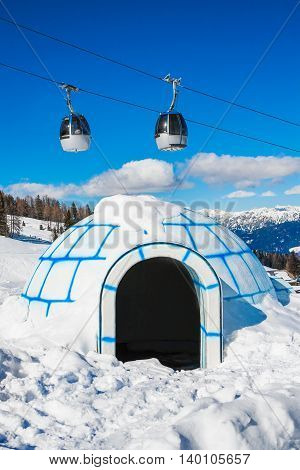Cable car and a plastic igloo in mountain ski resort Nassfeld, Austria.