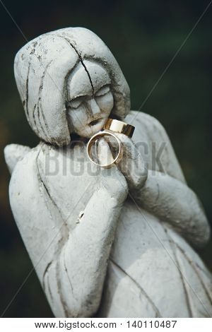 Stylish Pair Of Golden Wedding Ring On The Old Statues Woman, Time Concept