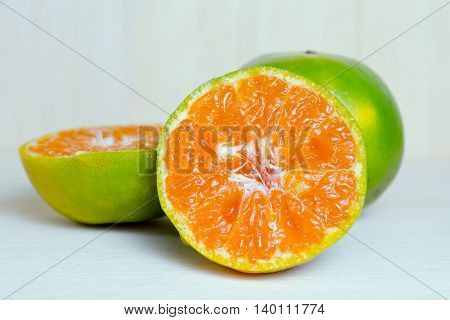 Orange Fruit With Half View Isolated On Wood Background