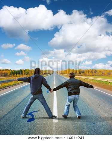 Two crazy guys on middle of the road
