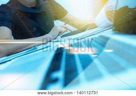 Businesswoman prepare and read data for discuss target on market at meeting room for decorate or design business content business background.(Pastel color)