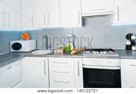 white modern kitchen with food on it, frontal view