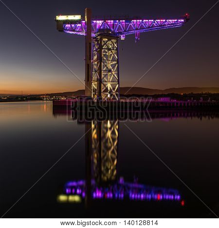 Reflections of the Titan Crane on the River Clyde at Clydebank in Scotland