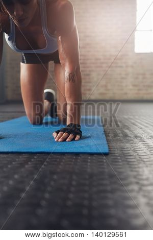 Young Woman Exercising On Fitness Mat