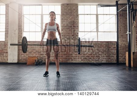 Muscular Woman In A Gym Doing Heavy Weight Exercises