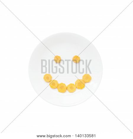 Smile face emotion by cut fresh carrot on ceramic circle dish isolated on white background with clipping path in cute concept of food