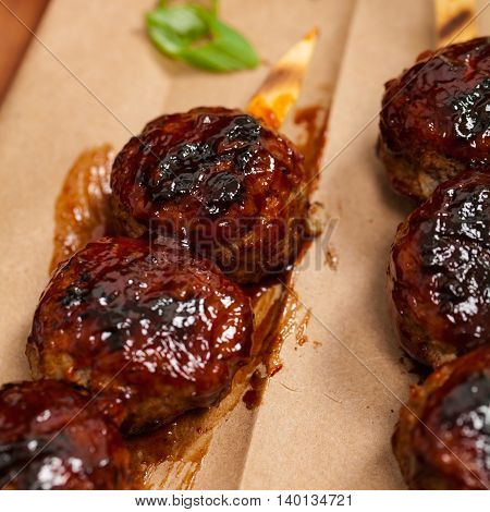 BBQ Meatballs in Barbecue Sauce. Selective focus.