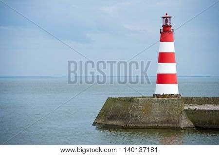 Lighthouse in Nida, Curonian Spit and Curonian Lagoon, Nida, Klaipeda, Lithuania. Nida harbour. Baltic Dunes. Unesco heritage.