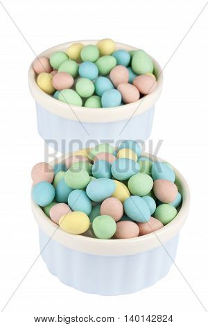bowl of colorful dyed easter eggs isolated on white background