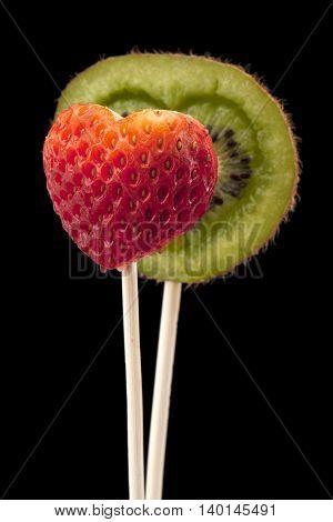 image of heart shaped kiwi and strawberry