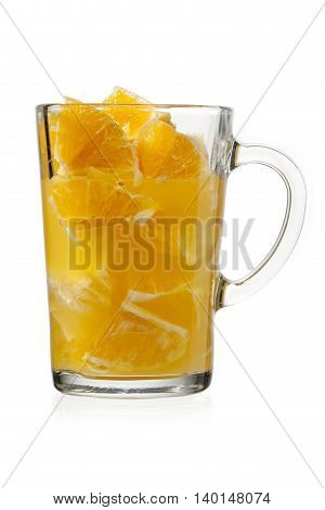 orange pulp and juice in glass isolated on white background