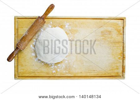 pizza dough and rolling pin on wooden worktop