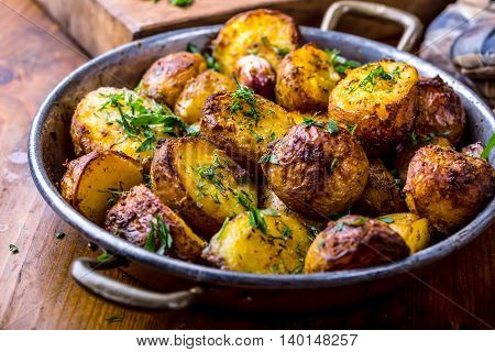 Potato. Roasted potatoes. American potatoes with smoked bacon garlic salt pepper cumin dill parsley - herb decoration.