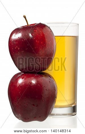 stack of apples and juice glass isolated on white background