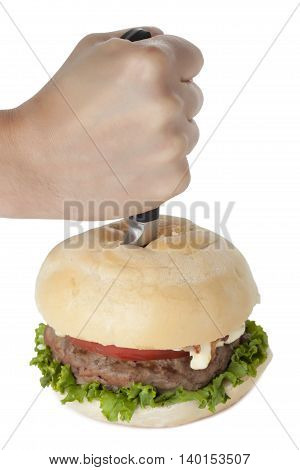 hand stabbing a hamburger isolated on white background