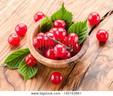 Nanking or felted cherry ftuits with leaves on the wooden table. poster