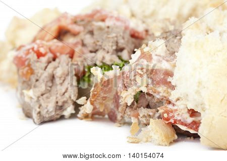 crushed hamburger closeup isolated on a white background