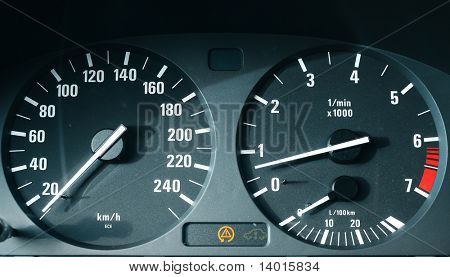 Car dashboard with speedometer (km/h) and tachometer