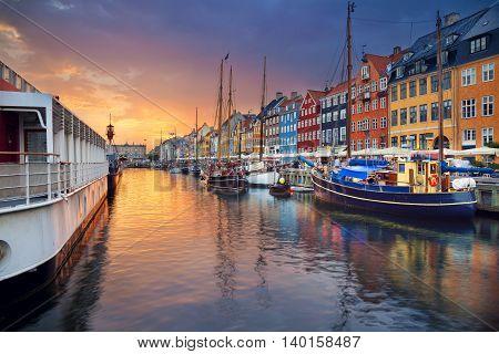 Copenhagen, Nyhavn Canal. Image of Nyhavn Canal in Copenhagen, Denmark during beautiful sunset.