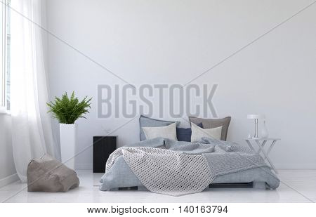 Modern minimalist white bedroom interior with a rumpled messy divan bed alongside a window with net drapes, monochromatic grey and white decor, 3d rendering