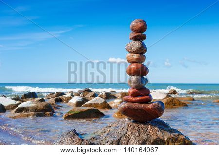 Concept of harmony and balance. Rock Zen on the storm background. Balance and poise stones against the sea