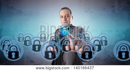 Business manager with positive face is picking one virtual lock icon among a crowd of multiples. Information technology concept for virtualization data privacy and information security management.