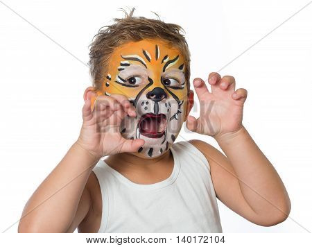 lovely boy child with face painted face as a tiger or lion