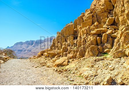 The hike among the rocky mountain slopes of Judean Desert Ein Gedi Israel.