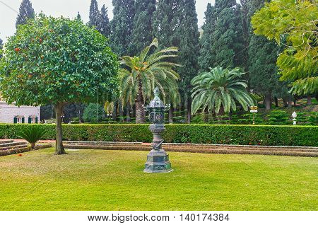 The meadow in Bahai Garden decorated with the Oriental style urn Haifa Israel.