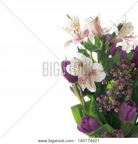 Spring flower bouquet of tulips and lilies on a white background