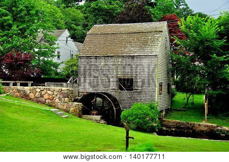 Sandwich Massachusetts- July 13 2015: The small wooden Dexter's Grist Mill and Water Wheel built in 1637 and still in use *