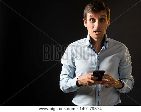 Very surprised russian guy with the phone