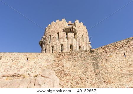 castle with battlements and walls of red stones, Villafames rural villa in Castellon, Valencia region in Spain