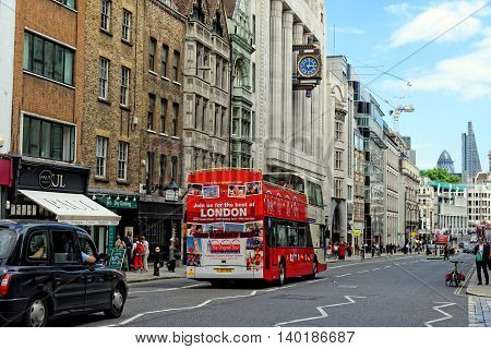 LONDON UK - JULY 1 2014: Fleet street in the City of London. It is named after the River Fleet London's largest underground river. It was once home of the British newspaper industry.