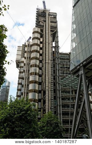 LONDON UK - JULY 1 2014: The Lloyd's Building also known as The Inside-Out Building home of insurance institution Lloyd of London. Like Pompidou Centre in Paris Lloyd was designed by Rogers 1986.