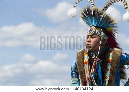 Coeur d'Alene Idaho USA - 07-23-2016. Native American youth. Young dancer participates in the Julyamsh Powwow on July 23 2016 at the Kootenai County Fairgrounds in Coeur d'Alene Idaho.