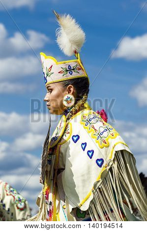 Coeur d'Alene Idaho USA - 07-23-2016. Profile of young woman at powwow. Young dancer participates in the Julyamsh Powwow on July 23 2016 at the Kootenai County Fairgrounds in Coeur d'Alene Idaho.