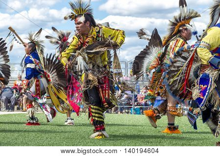 Coeur d'Alene Idaho USA - 07-23-2016. Male native American dancers at powwow. Young dancers participate in the Julyamsh Powwow on July 23 2016 at the Kootenai County Fairgrounds in Coeur d'Alene Idaho.