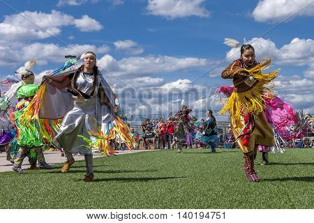 Coeur d'Alene Idaho USA - 07-23-2016. Two native American women at powwow. Young dancers participate in the Julyamsh Powwow on July 23 2016 at the Kootenai County Fairgrounds in Coeur d'Alene Idaho.