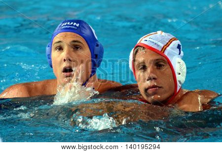 Budapest Hungary - Jul 14 2014. Balazs Sziranyi (ESP 7) and Norbert Hosnyanszky (HUN 6) fighting for the ball. The Waterpolo European Championship was held in Alfred Hajos Swimming Centre in 2014.