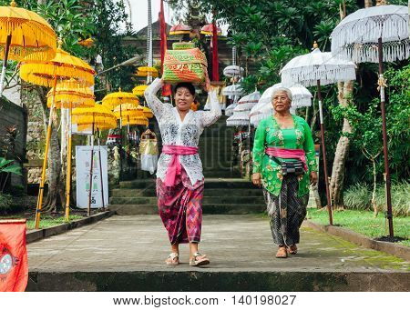UBUD INDONESIA - MARCH 2: Balinese women in traditional clothes during the celebration before Nyepi (Balinese Day of Silence) on March 2 2016 in Ubud Indonesia.