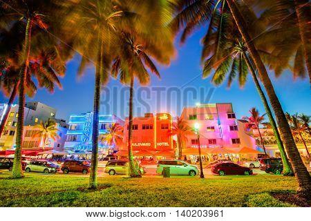 MIAMI, FLORIDA - JULY 5, 2016: Palm trees line Ocean Drive. The road is the main thoroughfare through South Beach.