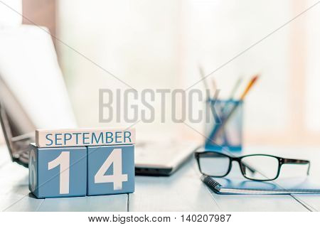 September 14th. Day 14 of month, calendar on auditor workplace background. Autumn time. Empty space for text.