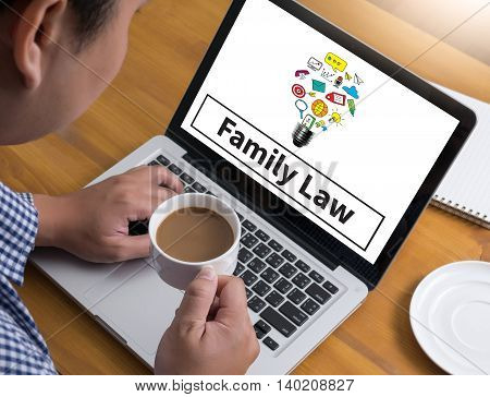 Family Law Businessman at work. Close-up top view of man working on laptop while sitting at the wooden desk coffee