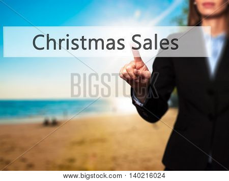 Christmas Sales - Businesswoman Pressing Modern  Buttons On A Virtual Screen
