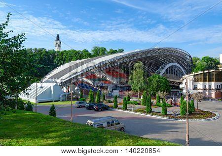 VITEBSK BELARUS - JULY 13 2016: Unidentified people are near summer amphitheater in Vitebsk Belarus. Amphitheater is traditional venue for popular festival Slavic Bazaar